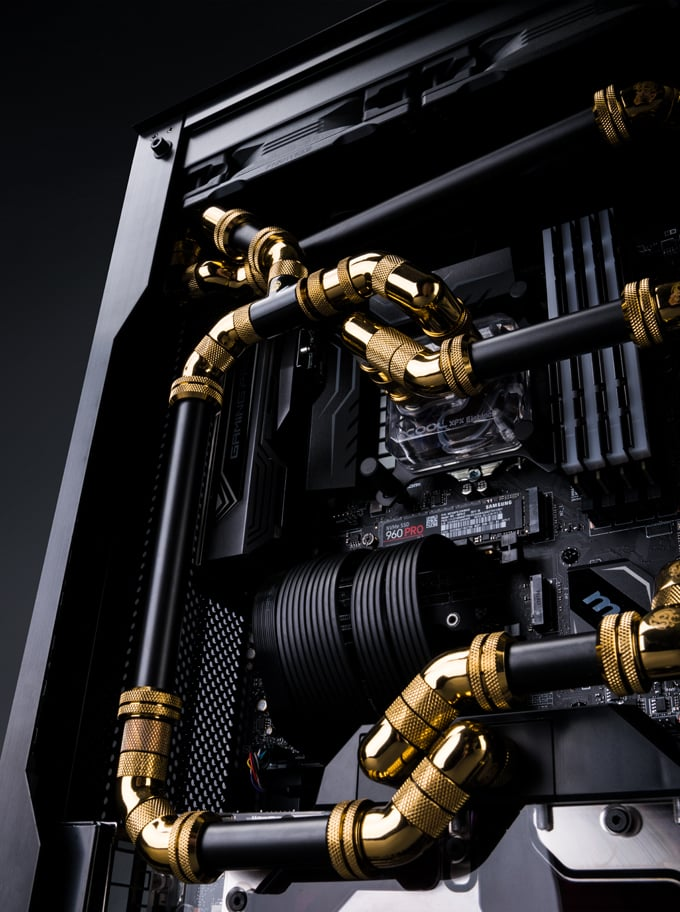 Black and gold fittings and tubing in a Maingear F131